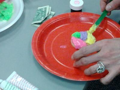 Adding frosting for the feelings on the Play Therapy Feeling Cookie.