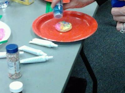 Making the play therapy cookie with sprinkles