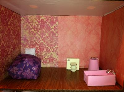 The pink room play therapy doll house