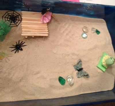 2nd photo of building a bridge in sand tray therapy class.