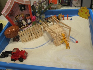 Sand Tray Therapy Class Assignment: House, Tree, Water, Sun, & Animal Sand Tray